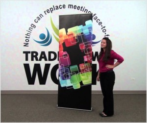tradeshow display cost a woman standing next do a tradeshow display
